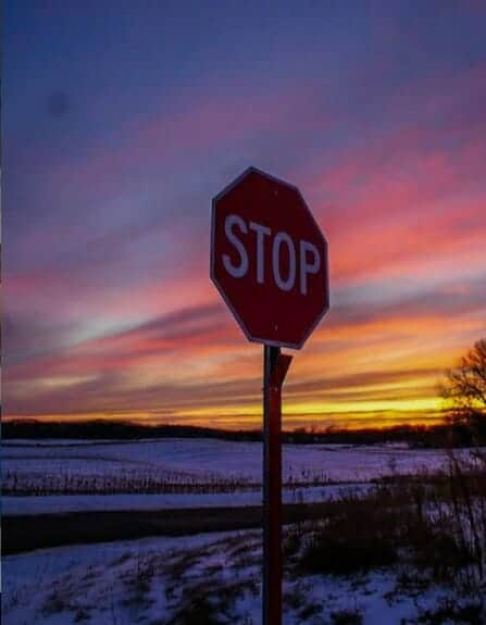 stop sign with sunset behind in Jackson Michigan